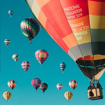 hot air balloons with text 'National Volunteer Week 2019, uplifting communities'